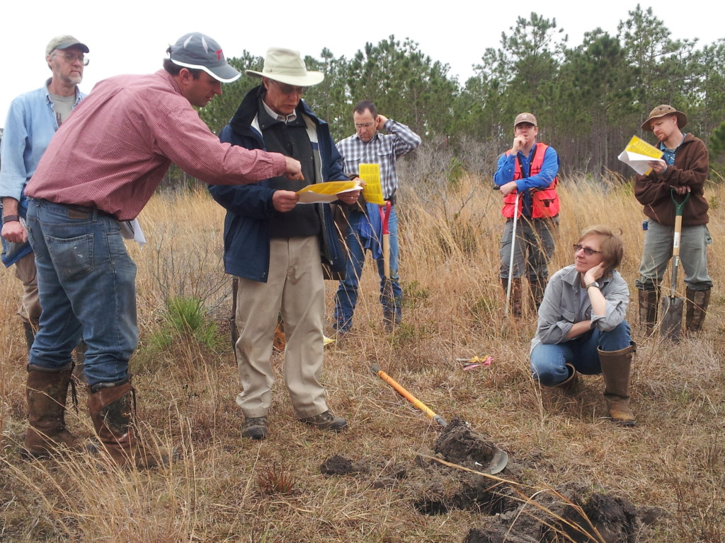 Dr. Mike Vepraskas works with students to identify soil type.