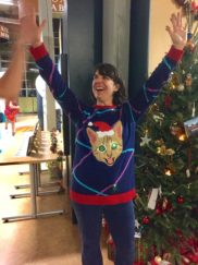 Dr. Ayesha Gray celebrates the announcement of being crowned with the crowd's favorite tacky sweater!